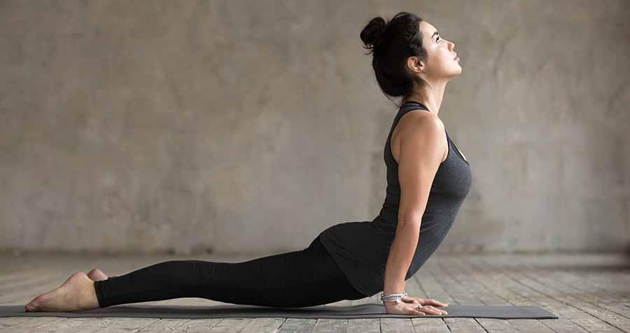 Yoga, posture du Chien tête en haut.